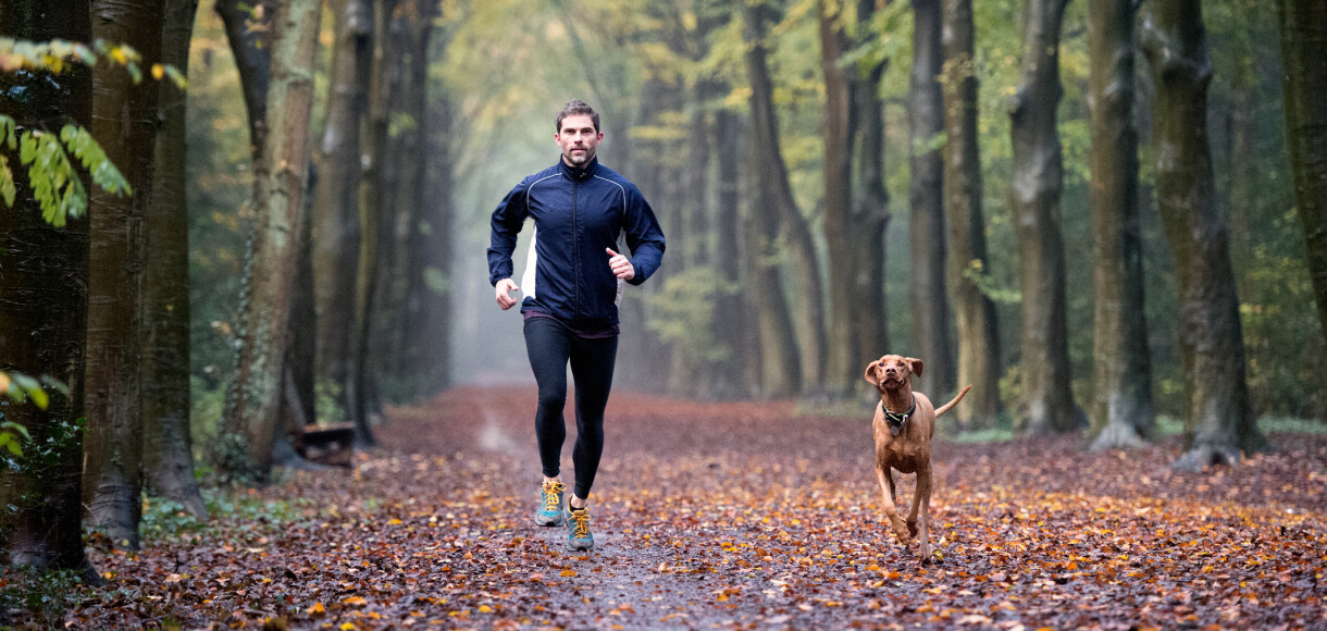 Man running in the Autumn forest