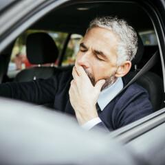 Tired man in car, Vienna, Austria