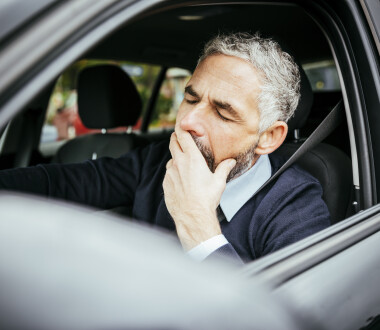 Tired man in car, Vienna, Austria