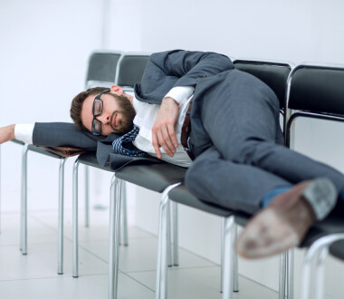 tired businessman lying on chairs and waiting for an interview.photo with copy space