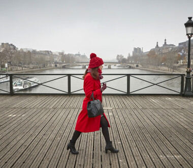 "PARIS, FRANCE - DECEMBER 05: A Parisian walks across the Pont des Arts bridge as many have to find alternative transport to get around the city as a nationwide strike grips Paris severely effecting transport across the city in the largest nationwide strike in years on December 05, 2019 in Paris, France. President Emmanuel Macron is facing his biggest test since the Gilet Jaune or ""Yellow Vest"" movement as railway, transportation workers, Teachers, students, hospital employees, police officers, garbage collectors, truck drivers and airline workers join the strike called in protest to changes to France's generous pension system. (Photo by Kiran Ridley/Getty Images)"