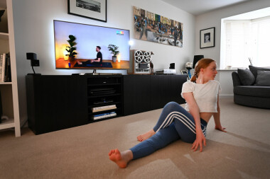 BRIXWORTH, ENGLAND - APRIL 13: Hollie Mason, the photographers daughter, partakes in a live virtual yoga class hosted by Nick Higgins on April 13, 2020 in Brixworth, England. On Monday April 13 at 10AM GMT Nick led a live virtual yoga class which he and Co-Founder Max Henderson hope to be the worlds largest yoga class. Their aim is to raise £125,000 for the NHS to support staff and key workers who are on the front line during the Covid-19 pandemic.(Photo by Clive Mason/Getty Images)