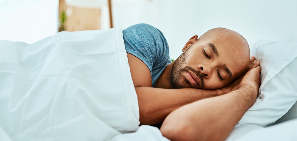Cropped shot of a young man sleeping in his bed